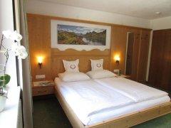 Komfortzimmer Bett I